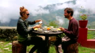 Tourist couple eating breakfast at Himalayas Mountains video