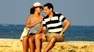 Tourist Couple Relaxing Near Ocean video