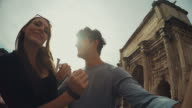 Tourist couple taking a selfie in Rome video