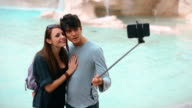 Tourist couple taking a selfie stick in Rome video