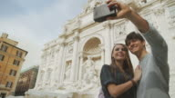 Tourist couple taking a selfie with vintage instant camera video