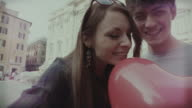 Tourist couple with heart baloon taking a selfie in Rome video
