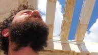 tourist man walking through ancient acropolis temple ruins, athens, greece video