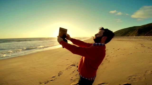 WS Tourist Photographing With Digital Tablet On Malibu Beach video