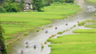 WS ZO Tourist ride boat for travel sight seeing Rice field on river 'Ngo Dong' at TamCoc, Ninhbinh, Vietnam; video