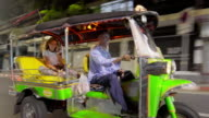 Tourist riding Tuk Tuk in Bangkok 4K video