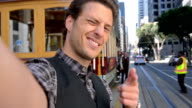 Tourist sending video selfie from San Francisco - POV video