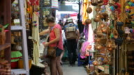 Tourist shopping in outdoor market in Bangkok video