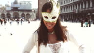 tourist smiling with venetian mask video