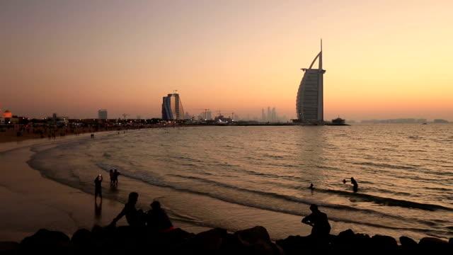 tourist taken photos on Jumeirah Beach video