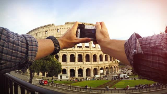 Tourist POV: taking a picture at the Coliseum, Rome video