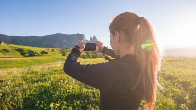 Tourist taking pictures of mountainous landscape video