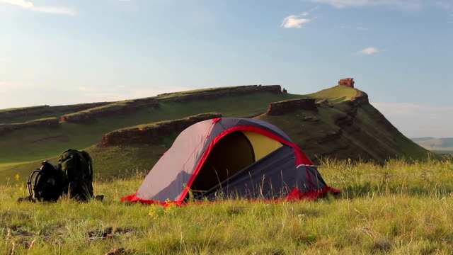 Tourist tent on meadow at the mountain in summer. video