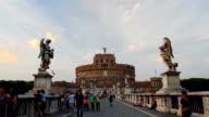 Tourist visit Castel Sant'angelo bridge and Berninis statue video