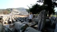 tourist visiting ruins ancient Ephesus video