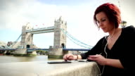 Tourist woman by the Tower Bridge in London video