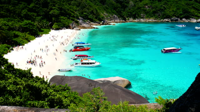 Tourists and boats on tropical Similan beach, Similan Island, Thailand video