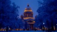 Tourists at night winter park against famous Saint Isaac's Cathedral video