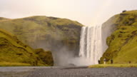SLO MO Tourists at Skogafoss waterfall in Iceland video