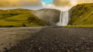 T/L Tourists at Skogafoss waterfall in Iceland video