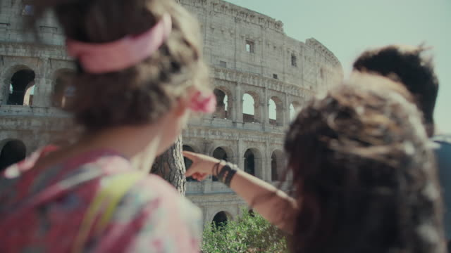 Tourists checking monuments of Rome on mobile phone video