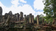 Tourists entering the ancient Bayon temple at Angkor, Siem Reap video