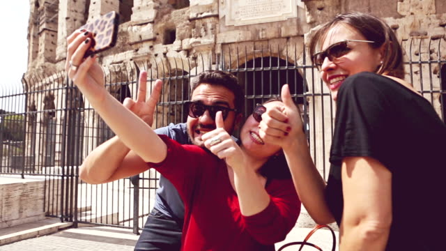 Tourists in Rome taking a selfie by Coliseum video
