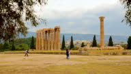 Tourists studying map to find the right way in territory of Olympian Zeus Temple video