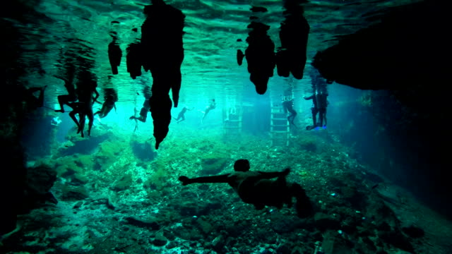 UNDERWATER Tourists swimming in groundwater well in famous Grand Cenote sinkhole video