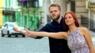 Tourists traveling hitchhiking video