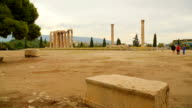 Tourists walking around Temple of Olympian Zeus in Athens, sightseeing tour video