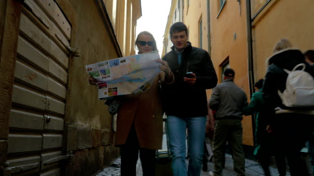 Tourists Walking Around The City Holding A Map video