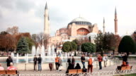 Tourists walking in Sultanahmet Square Hagia Sophia, a former Orthodox patriarchal basilica, later a mosque and now a museum in Istanbul, Turkey video