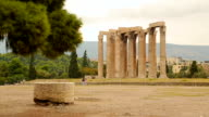 Tourists walking in territory of Olympian Zeus Temple, antique architecture video