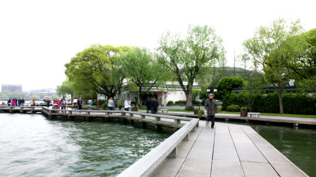 Tourists walking on stone bridge at westlake, time lapse. video