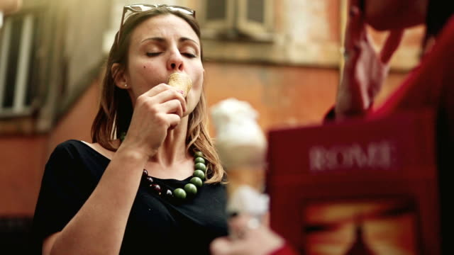Tourists with a guide eating icecream in Rome video