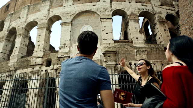 Tourists with a guide in front of the Coliseum, Rome video