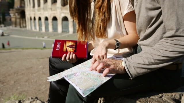 Tourists with guide and map in front of the Coliseum video