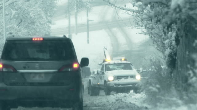 Tow ruck in winter storm video