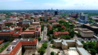 UT Tower Aerial Fly by Austin Texas Over University of Texas at Austin Capital Cities with Downtown Cityscape Skyline in the background at Center moving forwards video