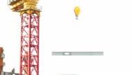 Tower crane lifting I-beam, HD video