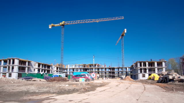 Tower cranes build large residential building in Moscow timelapse video