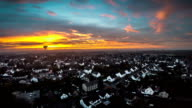 AERIAL : Town under moody sunset clouds video