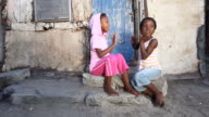 Township kids playing video