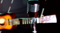 toy guitar and vintage microphone video