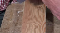 Tracing and drilling of a wooden board video