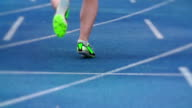Track and field athlete leaving start line in slow motion video