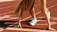 Track runners at starting line, slow motion video