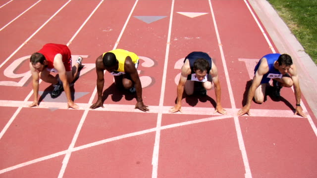 Track runners at starting line video