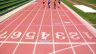 Track runners cross finish line video